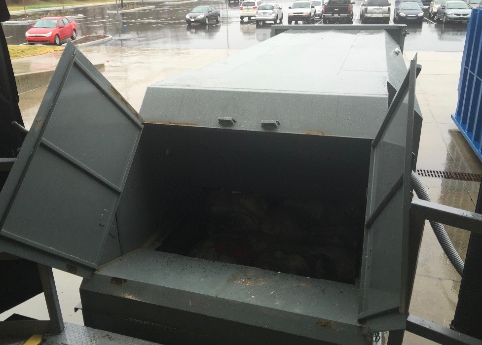 Dock-Friendly Self-Contained Compactor with Doghouse